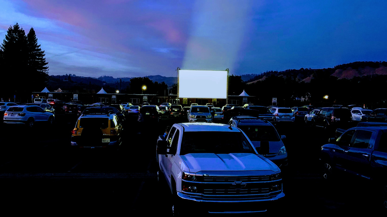 drive-in movie event with people in their cars at the luther burbank center for the arts parking lot in santa rosa california
